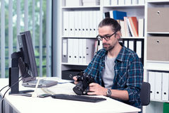 Photographer working in his office Royalty Free Stock Images