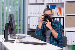 Photographer working in his office Stock Image