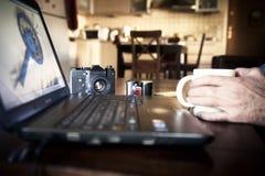 Photographer working on laptop Stock Image