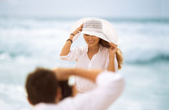 Photographer working with a model on the beach Royalty Free Stock Photos