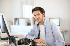 Photographer working at office Stock Photography