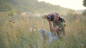 Photographer working outdoors. PhotoHunt. stock video
