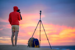 Photographer working outside in the early morning Royalty Free Stock Photo