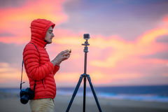 Photographer working outside in the early morning Royalty Free Stock Photography