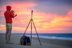 Photographer working outside in the early morning Stock Photos