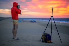 Photographer working outside in the early morning Royalty Free Stock Images