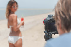 Ototshooting of the young lady in bikini at the beach Stock Photos