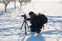 Photographer works in the winter Stock Photo