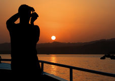 Photographer on the Yacht. Sea Sunset Stock Photos