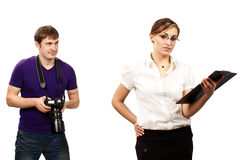 Photographer and a young serious businesswoman Royalty Free Stock Photography