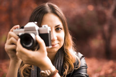 Photographer. The young photographer taking photos Royalty Free Stock Photo