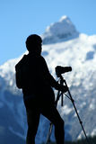 Photographer1. A photographer looking over the Tantalus Mountains royalty free stock photo