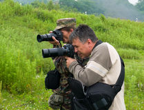 Photographers 1. Two photographesr shoot a photo on nature. Russian Far East, Primorye Royalty Free Stock Photography