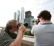 Photographers. Two photographers a shooting on the open air royalty free stock photography