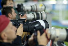 Photographers. With professional equipment working during a sport event Royalty Free Stock Image