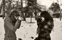 Photographers. Two girls photographers photographing each other royalty free stock images