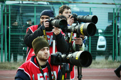Photographers. A group of sportive photographers during a football match.january 2012 stock photos