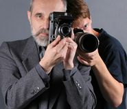 Photographers. Image about various generations of photographers and cameras Royalty Free Stock Image