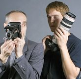 Photographers. Image about various generations of photographers and cameras Stock Photo