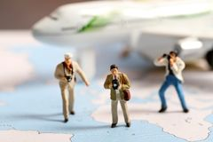 Photographers. Beautiful shot of photographers standing on world map stock photos