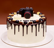 Photographers birthday cake with a photo camera on top Royalty Free Stock Images