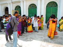 Photographers busy taking pictures of women. Kolkata, India - March 15, 2016: A bunch of photographers busy taking pictures of women on the eve of holi festival royalty free stock image