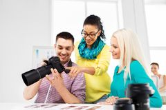 Photographers with camera at photo studio. Photography and creative people concept - photographers with camera at photo studio royalty free stock image