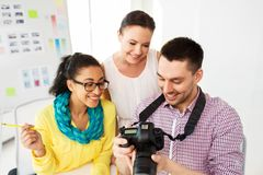 Photographers with camera at photo studio stock photos