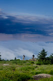 Photographers Capturing Footage on Roan Mountain. A pair of photographers observing the clouds rolling in over the Roan Mountain Highlands stock photography