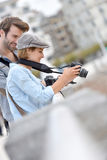 Photographers checking their photos on camera Royalty Free Stock Photography