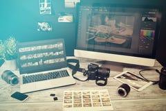 Photographers computer with photo edit programs. Photographer journalist camera photo dslr editing edit designer photography teamwork team memories lighting Royalty Free Stock Photos
