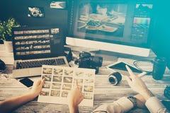 Photographers computer with photo edit programs. Photographer journalist camera photo dslr editing edit designer photography teamwork team memories lighting Stock Photos