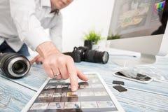 Photographers computer with photo edit programs. Photographer journalist camera traveling photo dslr editing edit hobbies lighting business designer concept Stock Image