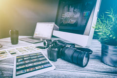 Photographers computer with photo edit programs. Photographer photographic photograph journalist camera traveling photo dslr editing edit hobbies lighting Stock Photography