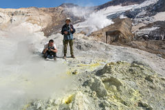 Photographers in crater of active Mutnovsky Volcano. Kamchatka Royalty Free Stock Images