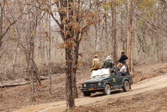 Photographers eagerly waiting for tiger sighting in Pench Tiger reserve. SEONI, INDIA-JUNE 26: Tourist moving in Safari jeep during game drive in Pench Tiger royalty free stock photos