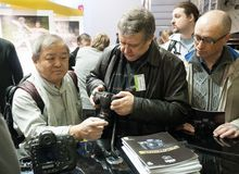 Photographers examine new Nikon products Royalty Free Stock Photo