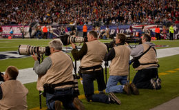 Photographers at field. Professional Photographers take images from the sidelines at Gillette Stadium, the home of Super Bowl champs, New England Patriots vs royalty free stock photography