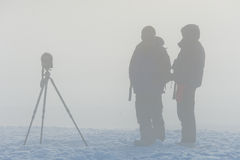 Photographers in the fog Royalty Free Stock Photos