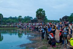 Photographers gather near Angkor Wat pond sunrise Stock Image