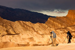 Photographers Hunting for Light. Photographers at sunrise at Zabriskie Point in Death Valley National Park, California royalty free stock images