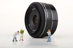 Photographers miniatures and Photographic lens Stock Images