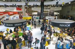Photographers at Nikon stand. Royalty Free Stock Image
