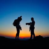 Photographers outdoor at sunset Royalty Free Stock Photo