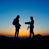 Photographers outdoor at sunset Royalty Free Stock Photography