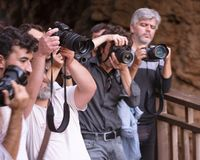 Photographers paparazzi are shooting with the professional camera - Antalya, Turkey, 30.10.18. Photographers paparazzi are shooting with the professional cameras royalty free stock photography