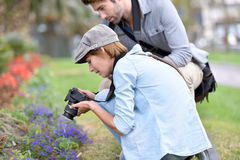 Photographers in park shooting macro Royalty Free Stock Photos
