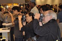 Photographers photograph a female model posing for photographers stock photos
