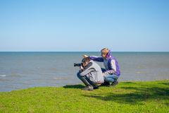 Photographers. On seashore royalty free stock photo