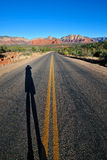 Photographers shadow on road Stock Images